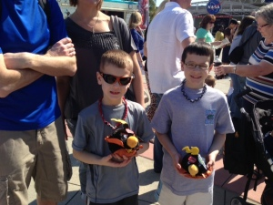 Nick and Tommy Manning wait with their souvenirs to see Angry Birds Space at KSC